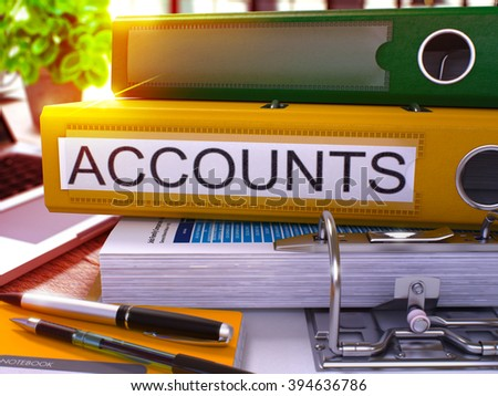 Yellow Office Folder with Inscription Accounts on Office Desktop with Office Supplies and Modern Laptop. Accounts Business Concept on Blurred Background. Accounts - Toned Image. 3D Render.