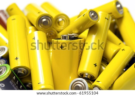 yellow old batteries on white background ready to disposal and recycle - stock photo