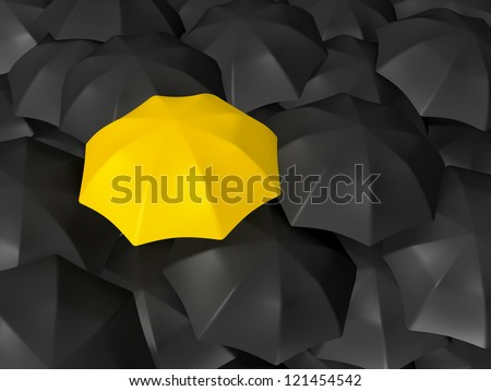 Yellow open umbrella standing out from the crowd, over many dark ones, group of black umbrellas. - stock photo