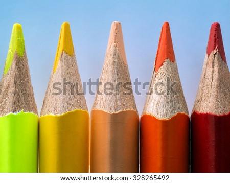 Yellow, orange and red pencil. Macro. Warm colors - stock photo