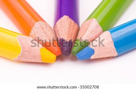 Yellow, orange, violet, green, blue pencils - stock photo