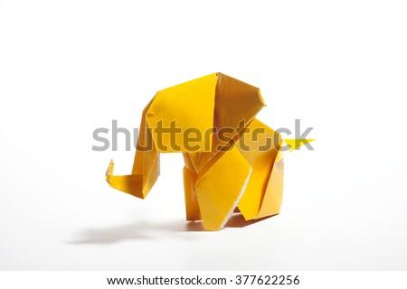 Yellow origami elephant  isolated on white background  - stock photo