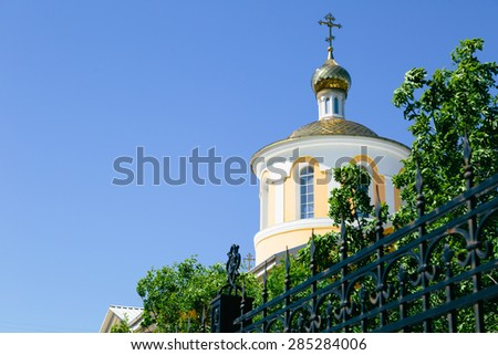 Yellow orthodox church against the blue sky