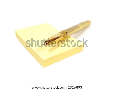 yellow pages of notebook with golden penl - stock photo