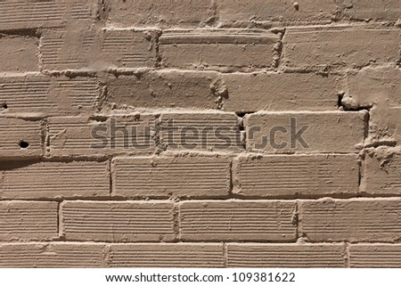 Yellow paint brick wall background pattern