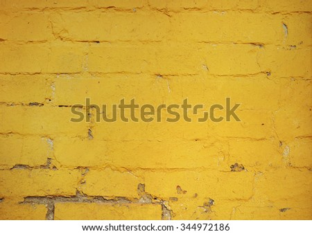 Yellow painted brick wall surface.  - stock photo
