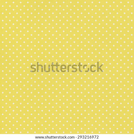 Yellow paper background with polka dot pattern - stock photo