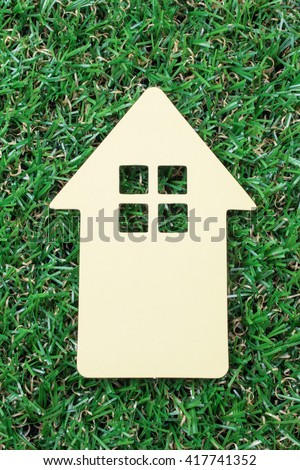 Yellow Paper House on Green Grass.