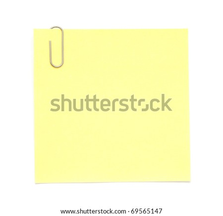 Yellow paper note with paper clip - stock photo