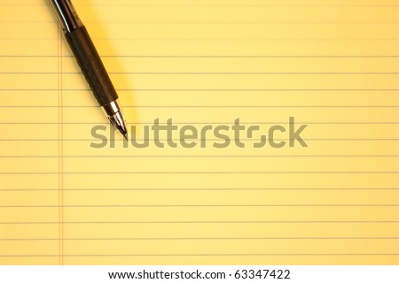 Yellow paper with pen - stock photo