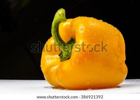 Yellow paprika on a black background - stock photo