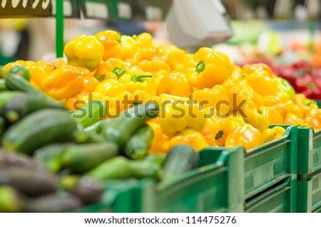 Yellow paprika peppers in boxes in supermarket