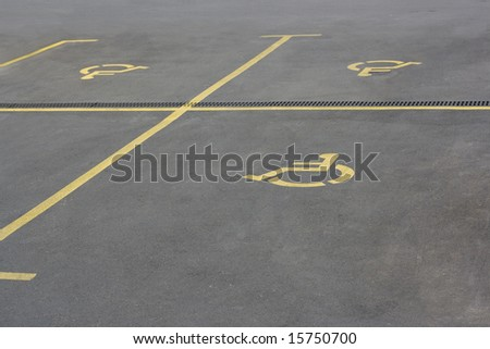 Yellow parking sign for handicaped people - stock photo