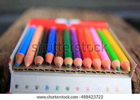 yellow pencil in pencil sharpener on brown
