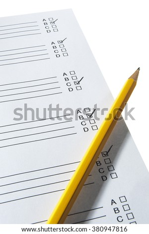 Yellow pencil on exam paper over white background - stock photo