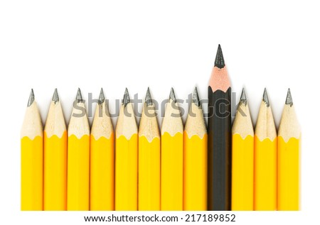 Yellow pencils with on black pencil on white background - stock photo