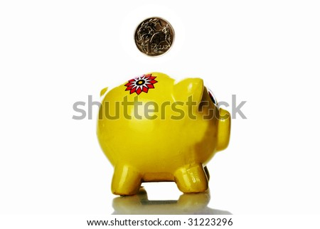 Yellow Piggy Bank against white background - stock photo