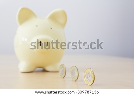 Yellow piggy bank and Polish currency, PLN