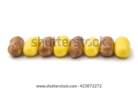 yellow pills isolated on a white background