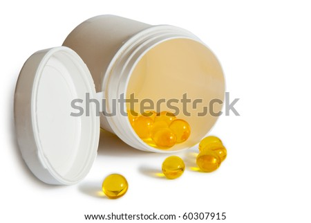 yellow pills with container isolated on white