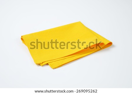 yellow place mat on white background - stock photo