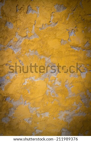 Yellow plastered wall texture for your design