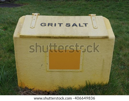 Yellow Plastic Container for Grit or Salt to Put on the Roads in case of Snow or Ice in the Coastal Town of Abbotsham, Devon, England, UK - stock photo