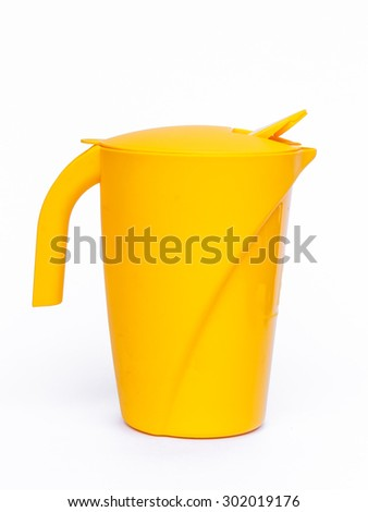 Yellow plastic glass on white background - stock photo