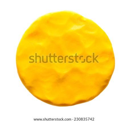 Yellow plasticine circle isolated on white background - stock photo