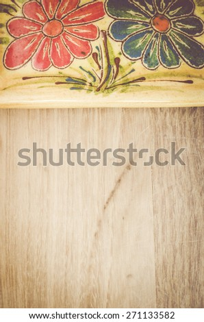 yellow porcelain tablemat on a pastel green wood background - stock photo