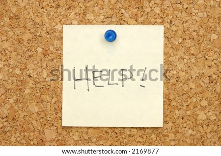 Yellow post-it note asking for help on corkboard