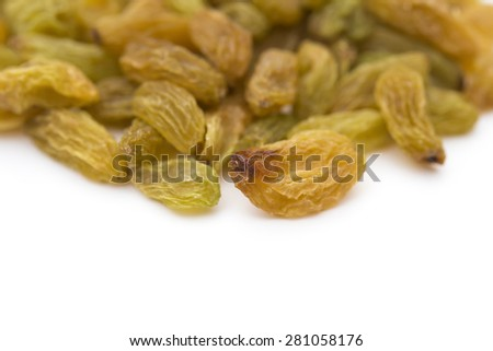 yellow raisins on a white background with copy space - stock photo