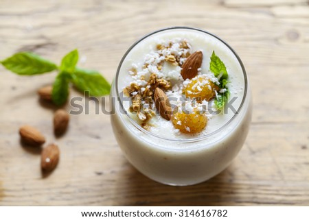 Yellow raspberries smoothie with coconut and almonds