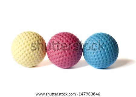 Yellow, Red and Blue colored Mini Golf balls on an isolated background - stock photo