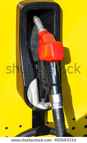 Yellow ,red and blue of fuel nozzle, difference color symbol for  benzine,gasoline and diesel. - stock photo