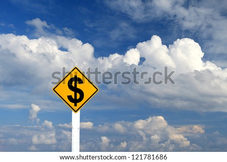 Yellow Rhombus Road Sign With Dollar Sign Inside On Blue Sky Background with blank for text - stock photo