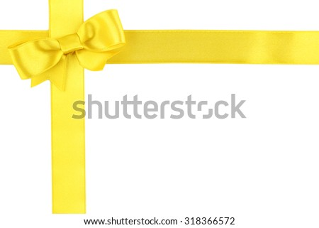 Yellow ribbon bow isolated on white