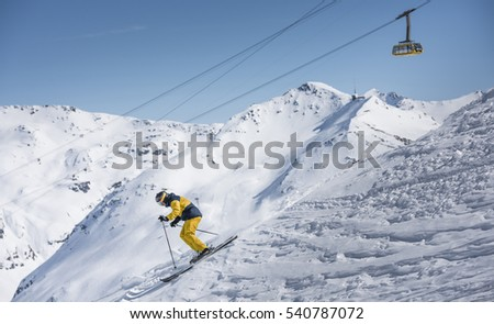 Yellow rider with mountain cable car