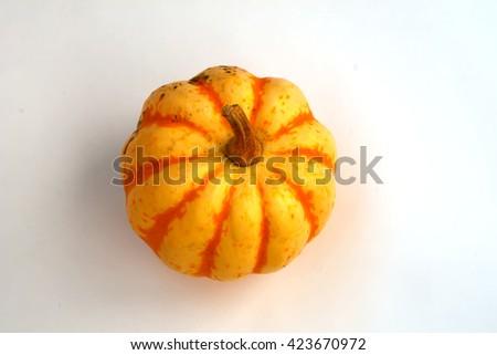 Yellow ripe orange pumpkin on a white background - stock photo