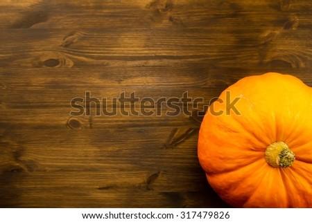 Yellow ripe pumpkin on wooden background. Thanksgiving, autumn. - stock photo