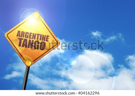 Yellow road sign with a blue sky and white clouds: Argentine tango - stock photo