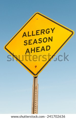 yellow road sign with the words: Allergy Season Ahead