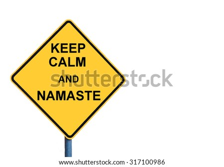 Yellow roadsign with KEEP CALM AND NAMASTE message isolated on white background