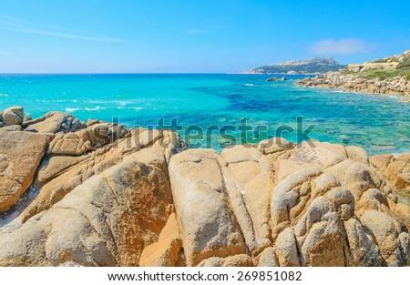 yellow rocks by Santa Reparata beach in Sardinia - stock photo