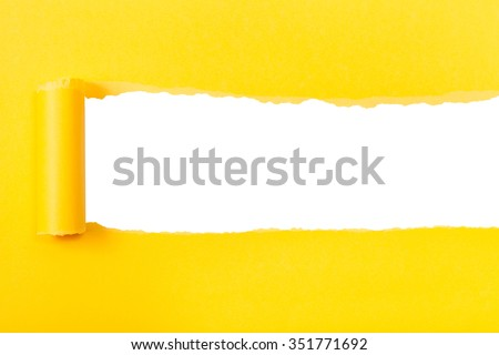 yellow rolled-up torn paper on white isolated background