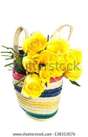Yellow roses in wooden shopping bag isolated over white
