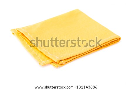 Yellow rough linen tablecloth on a white background. - stock photo