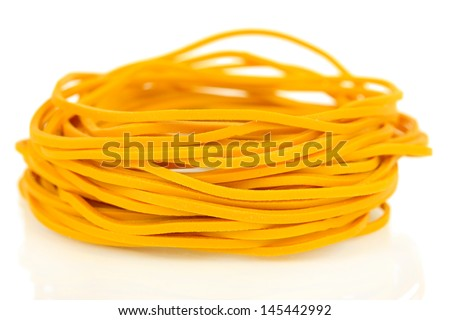 Yellow rubber bands isolated on white - stock photo