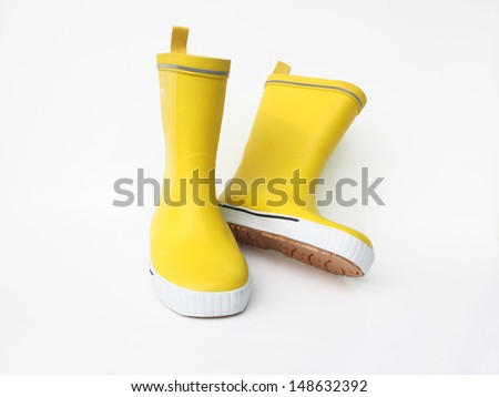 yellow rubber boots isolated on white background - stock photo
