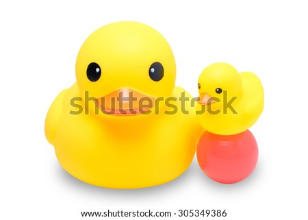 yellow rubber duck with colorful ball in isolate white background - stock photo